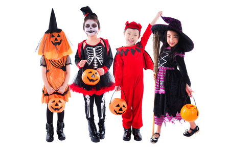 Group of asian children wearing halloween costume standing over white background Stock Photo