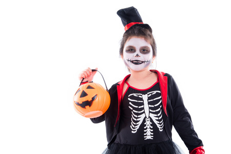 Happy asian girl in halloween skeleton costume isolated over white background Stock Photo