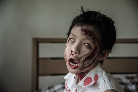 Young Asian boy in zombie make up for Halloween