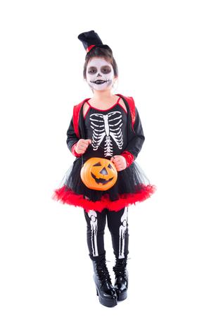 Full length of happy asian girl in halloween skeleton costume isolated over white background