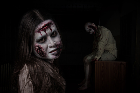 Two scary zombie in darkroom ,people make up for Halloween. Stock Photo