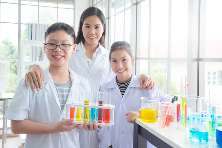 Young asian student smiling with their teacher in chemistry classroom Stock Photo
