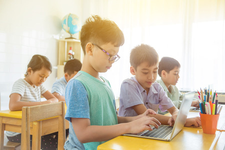Group of young asian students studying in classroom.