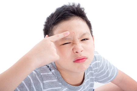 Asian teenager with acne on his face isolated over white background