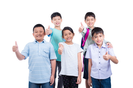 Group of students standing and showing thumb up over white background