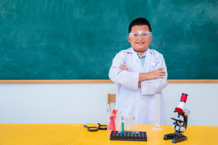 Young asian student standing and smile in science classroom Stock Photo