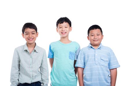 Three school boy standing over white background