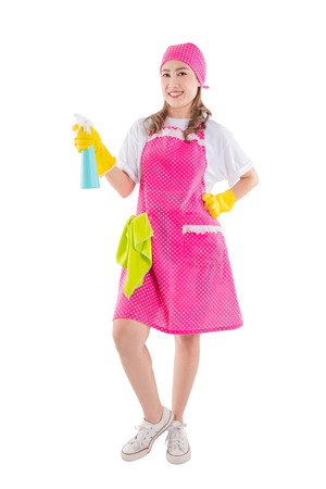 Full length of beautiful asian maid in pink apron isolated over white background