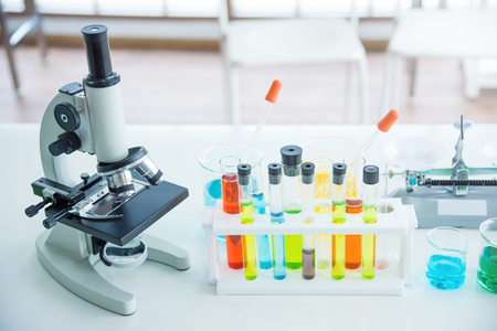 Microscope with many test tubes in the laboratory Stock Photo