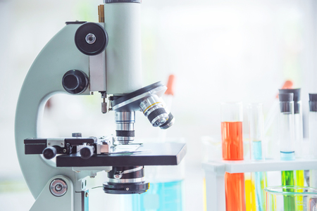 Closeup microscope with test tubes in the laboratory Stock Photo