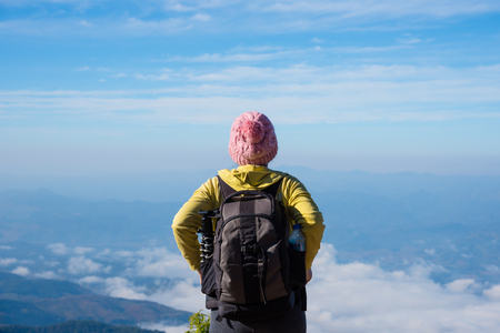 Middle aged female hiker enjoying beautiful morning view in the mountains in Thailand Stock Photo
