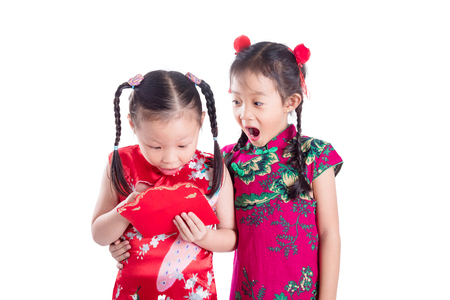 Chinese children opening red packet money over white background