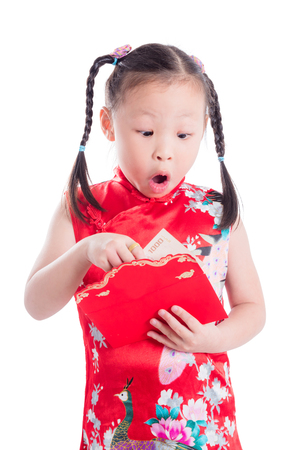 Little Chinese girl opening red packet money over white background