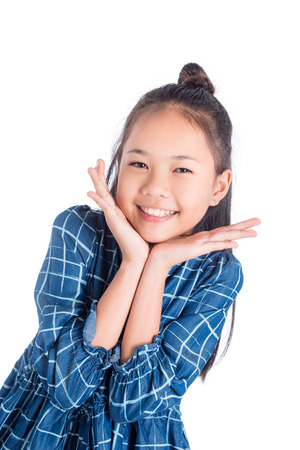 Cute teenager asian girl smiling over white background Imagens