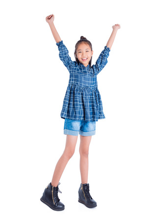 Full length of teenager asian girl smiling over white background Stok Fotoğraf