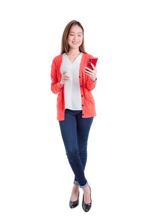 Full length of beautiful asian woman holding smart phone and coffee cup isolated over white background 版權商用圖片