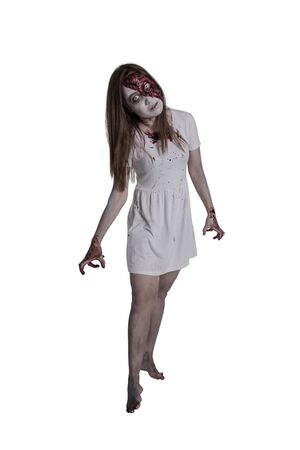 Full length of make up zombie woman standing over white background