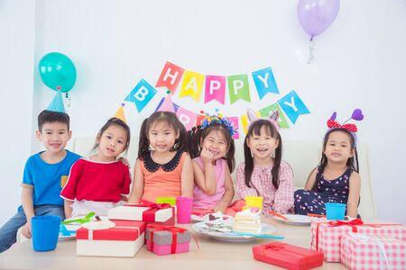 Group of adorable asian kids having fun at birthday party Stock fotó