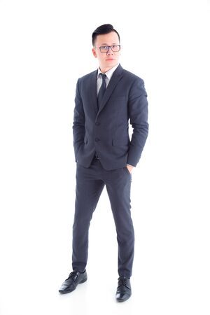 Full length of handsome asian businessman wearing suit standing isolated over white background 写真素材
