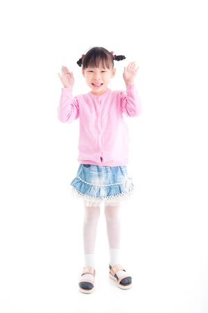 Little asian girl standing with open arm and smiles over white background