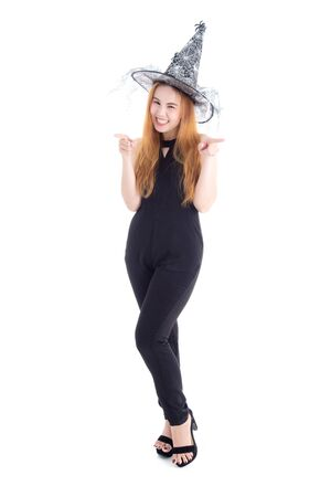 Pretty asian woman in black bodysuit wearing witch hat for Halloween festival isolated over white background.