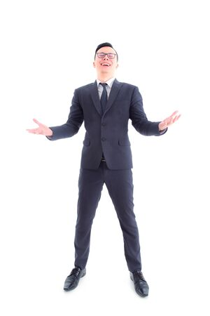 Full length of handsome asian businessman wearing suit laughing isolated over white background