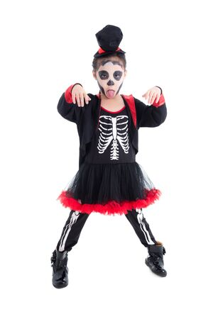 Full length of asian girl in skeleton costume standing over white background 写真素材