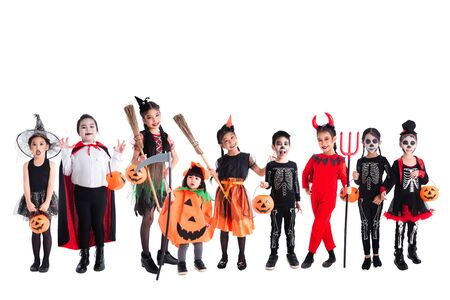 Group of many asian children wearing and makeup for Halloween celebration standing over white background