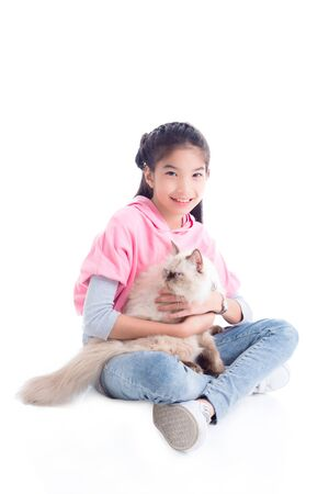 Pretty asian girl sitting on the floor and holding her cat with smiles over white background 写真素材