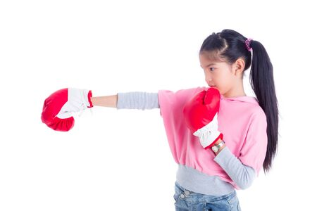 Beautiful asian girl wearing red boxing gloves punching over white background, exercise and healthy concept .