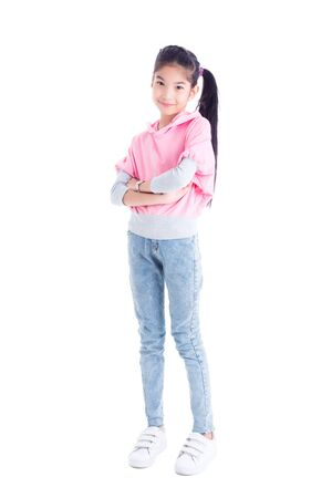 Full length of asian pretty girl standing and smiles over white background 写真素材
