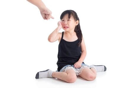 Sad asian girl crying while her mother punish her over white background, Child abuse concept. Stock fotó