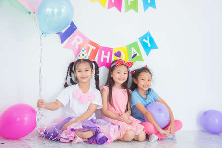 Group of asian children sitting and smile together at birthday party.