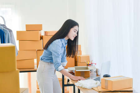 Female startup small business owner standing and working