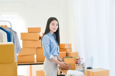 Female startup small business owner standing with smiles