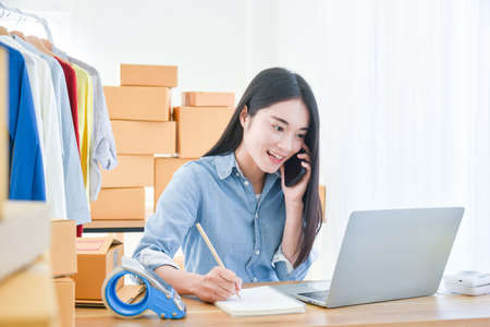 Female startup small business owner sitting and working