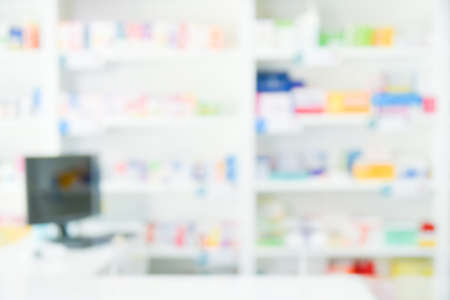 Blur pharmacy drugstore abstract background with medicine and healthcare product on shelves.