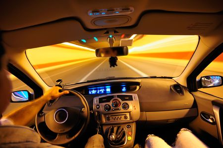 car inside: Couple traveling with a car inside a tunnel during night Stock Photo
