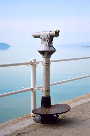 turistic: Old turistic telescope by the lakeside