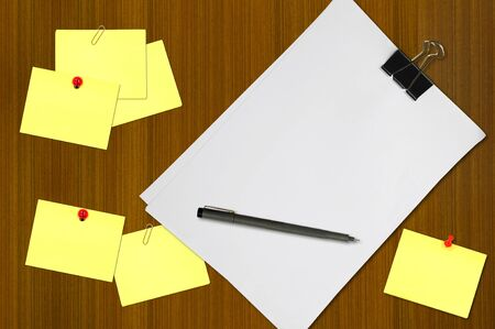 Yellow memo and white blank note paper with pen Stock Photo - 8561543