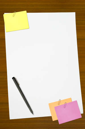colored memo and white blank note paper with pen photo