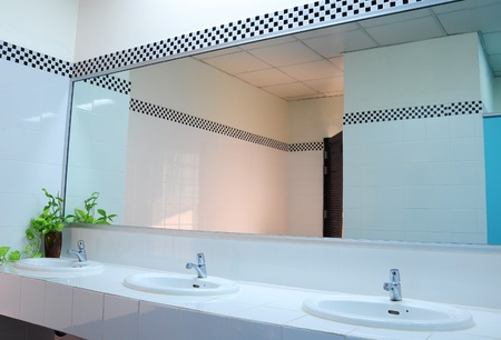 mirror: Bathroom at office.Handbasin and mirror in toilet