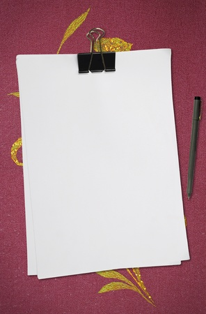 white blank note paper with pen on red fabric Stock Photo - 8718948