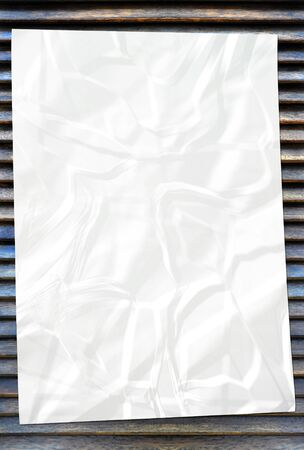 white crumpled paper on wood background Stock Photo - 8896304