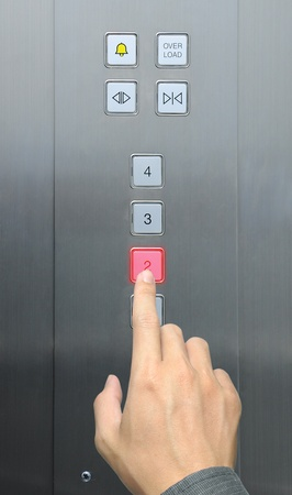 businessman hand press 2 floor in elevator photo