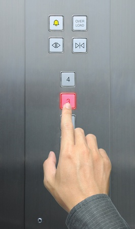 businessman hand press 3 floor in elevator photo