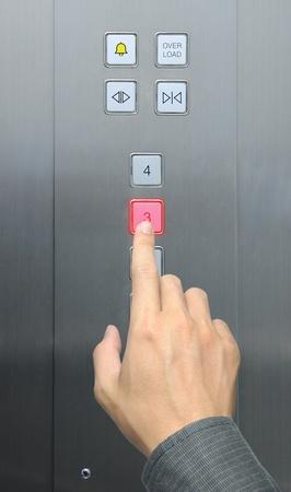 businessman hand press 3 floor in elevator Stock Photo - 8896325