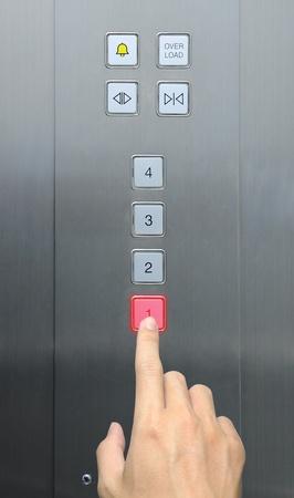 businessman hand press 1 floor in elevator Stock Photo - 8896322