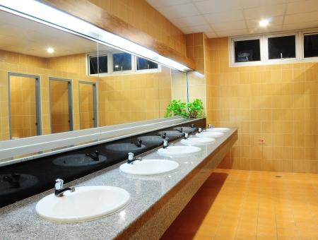 Handbasin and mirror in toilet photo
