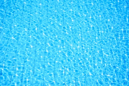 blue swimming pool with ripple water and reflection  photo